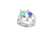 Ring in 18kt white gold with emerald, sapphire and brilliant.
